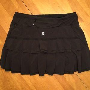 Lululemon rRuffle butt black skirt. Great shape!